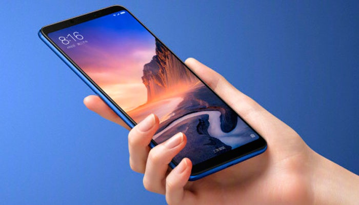 Xiaomi Mi Max 3 in use with blue background