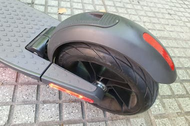 The rear fender has the system to hook the steering bar to the base of the scooter