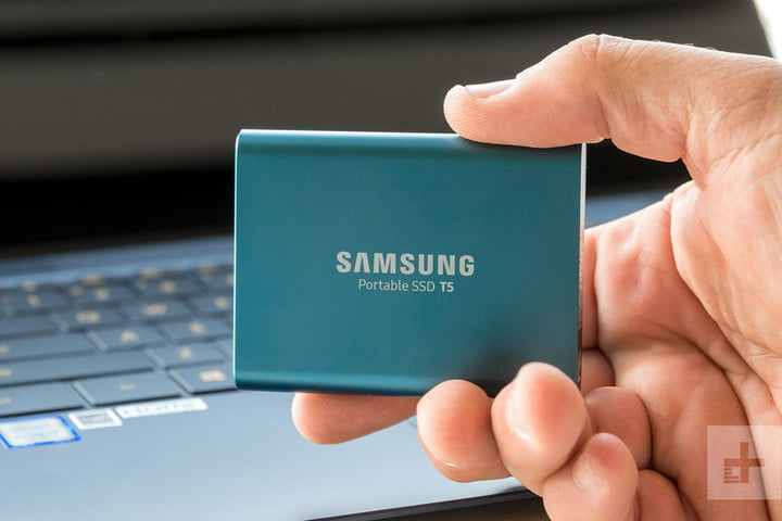 external hard drive in one hand