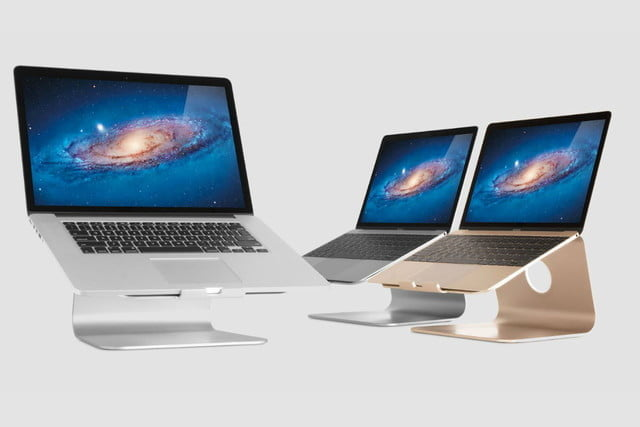 Three computers on laptop stands