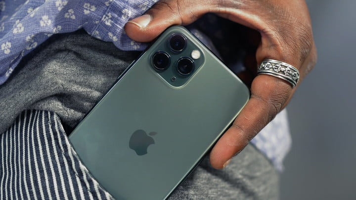A person keeps in his pocket the iPhone 11 Pro, one of the best waterproof phones