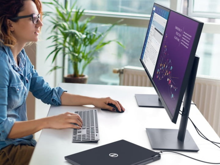 Woman working in front of a Dell monitor