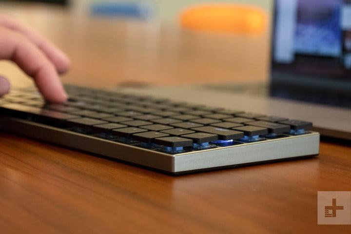 Fingers of a hand on Best mechanical keyboard for Macs: Vinpok Taptek keyboard that is on a wooden desk
