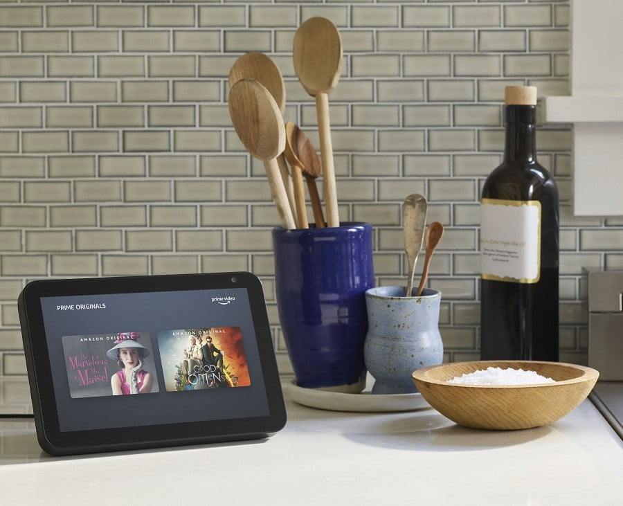 Amazon Echo Show device and kitchen utensils on a countertop