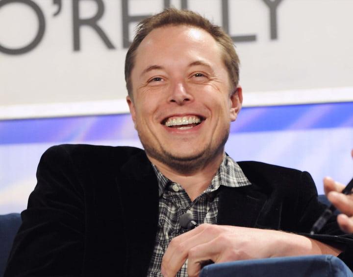 Elon Musk smiles