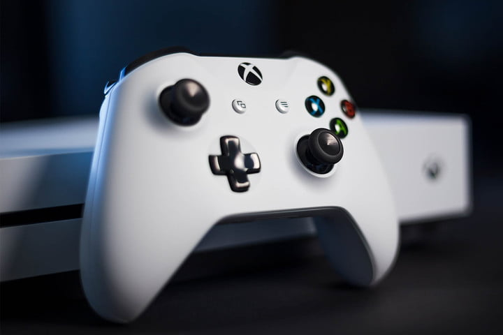 White Xbox controller in front of a console to learn how to play Xbox One on Windows 10 computer