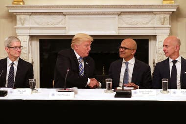 Tim Cook of Apple, Satya Nadella of Microsoft and Jeff Bezos of Amazon during a meeting with President Donald Trump in 2017