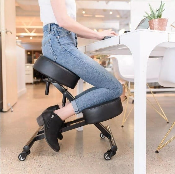 Woman sitting in a Sleekform chair model atlanta leather, ergonomic furniture together with ergonomic mouse will help you improve your posture