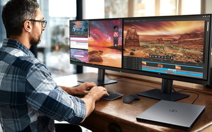 A man showing how to configure two monitors in Windows 10